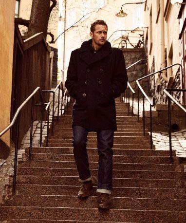 Alexander Skarsgård walking down a street