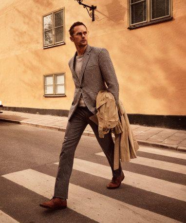 Alexander Skarsgård crossing a street