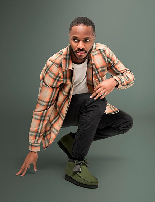Raheem Sterling wearing the Wallabee boot in khaki nubuck