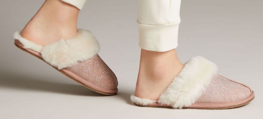 Close-up shot of women's blush pink leather mule slippers with shearling lining, Warm Glitz