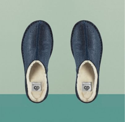 Close-up shot of women's navy clog-inspired fabric slippers, Step Flow Clog