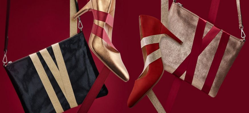 Stylised shot of women's gold and red heels, with matching gold and black bags