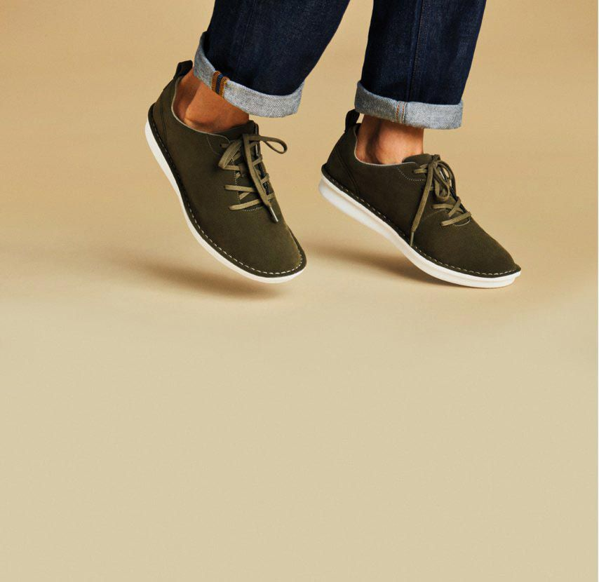 Close-up of a pair of Step Welt Free lace-up casual sports-inspired shoes in Khaki