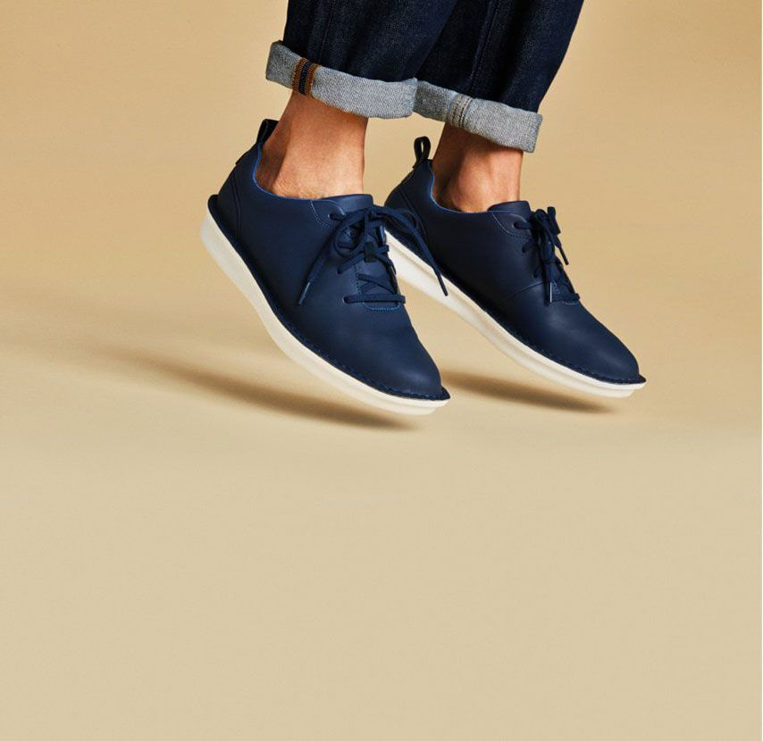 Close-up of a pair of Step Welt Free lace-up casual sports-inspired shoes in Navy