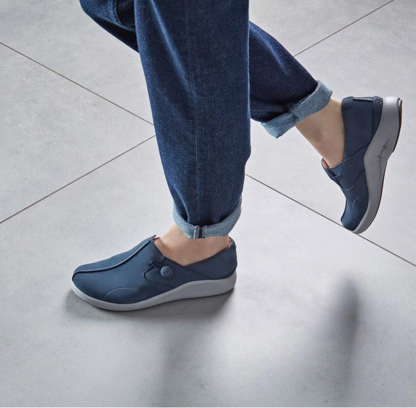 Close-up of a pair Navy Nubuck UnLoop Walk with a button loop fastening