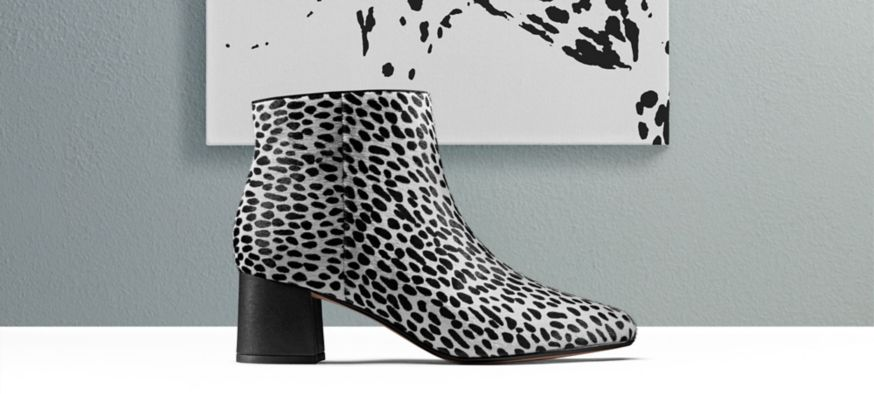 A single black and white leopard print ankle boot