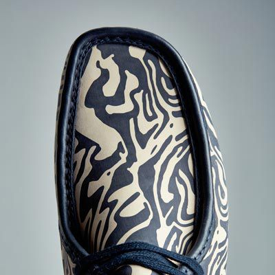 Wu Wear Wallabee in blue and cream on a patterned background