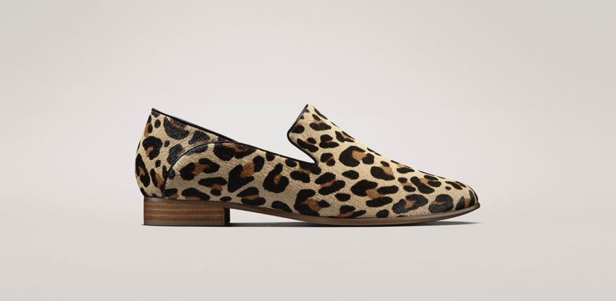 Profile shot of a leopard print slip on shoe, with leather lining