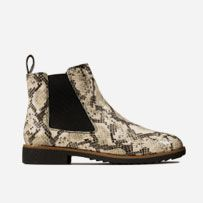 Profile shot of a taupe snake skin ankle boot, with Chelsea boot detailing
