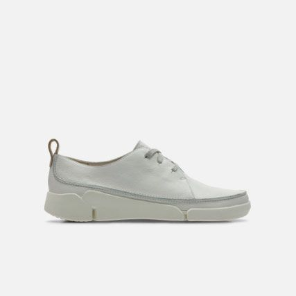 Side view of a white leather trainer with a chunky sole