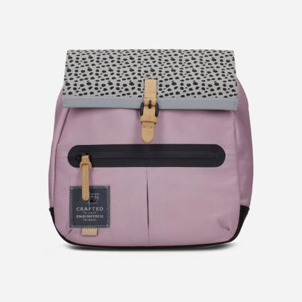 Shot of play small, a pink synthetic backpack featuring a leopard spot rolltop, zip closures and magnetic fastenings
