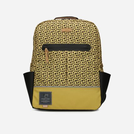 Yellow leopard spot synthetic backpack featuring exterior slip pockets and reflective straps